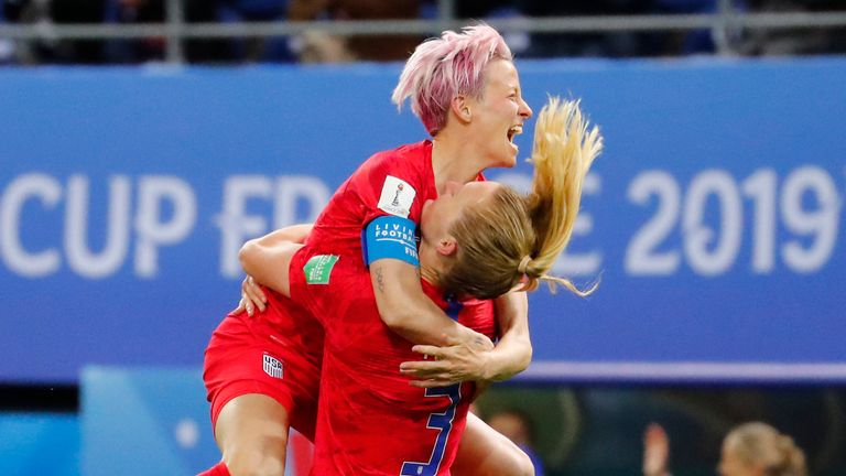 United States midfielder Sam Mewis celebrates with forward Megan Rapinoe after scoring against Thailand