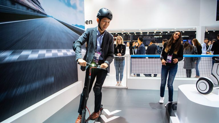 BARCELONA, SPAIN - FEBRUARY 26: A visitor tests a scooter at the Xiaomi booth on day 2 of the GSMA Mobile World Congress 2019 on February 26, 2019 in Barcelona, Spain. The annual Mobile World Congress hosts some of the world's largest communications companies, with many unveiling their latest phones and wearables gadgets like foldable screens and the introduction of the 5G wireless networks. (Photo by David Ramos/Getty Images)