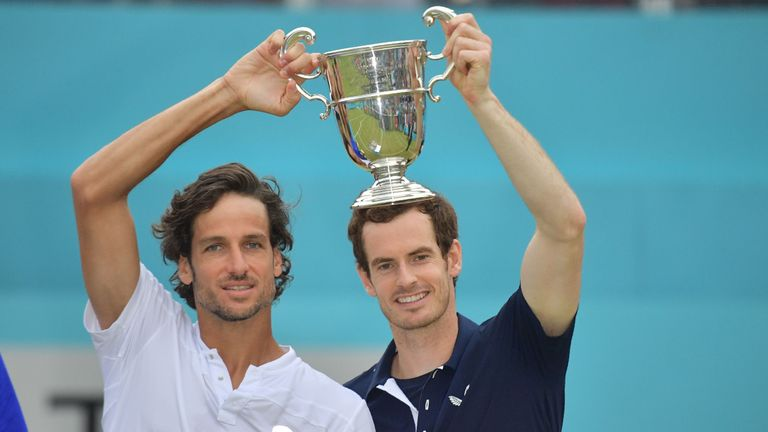 Andy Murray (R) and Spain's Feliciano Lopez pose with the trophy after their win in the men's doubles final tennis match against US player Rajeev Ram and Britain's Joe Salisbury at the ATP Fever-Tree Championships tournament at Queen's Club in west London on June 23, 2019