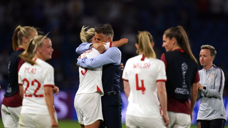 England boss Phil Neville celebrates victory with Steph Houghton