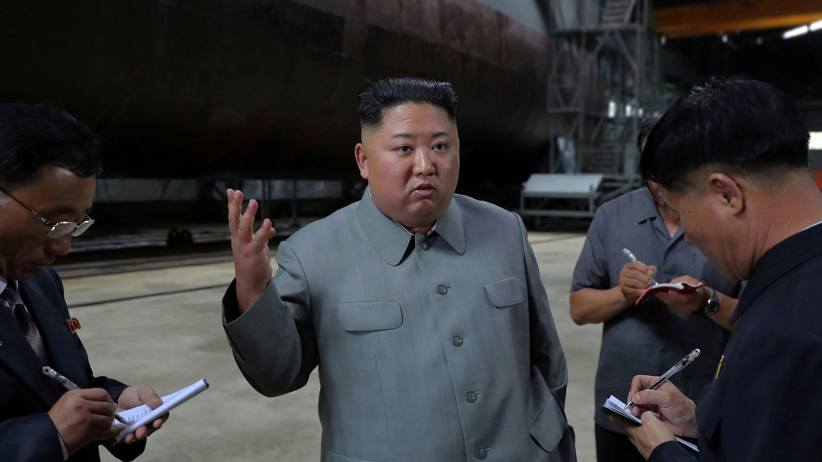 Ballistic missile fears as Kim Jong Un inspects newly built submarine