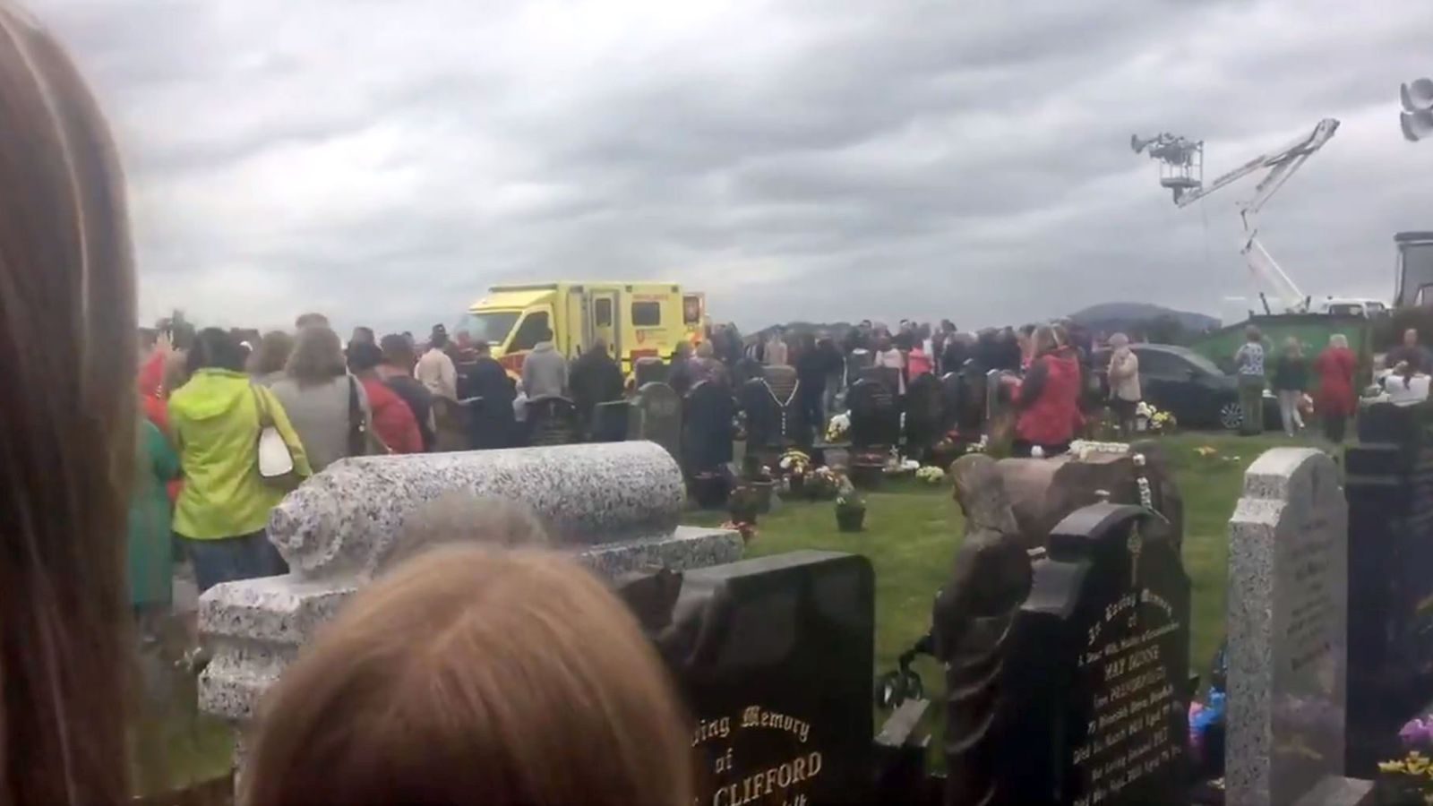 Several injured as car collides with crowds at cemetery