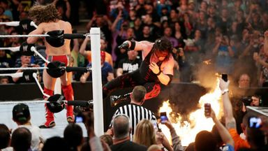Kane goes through flaming table!