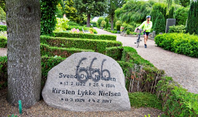 Vandals spray paint graves in Denmark with Satanic '666' graffiti