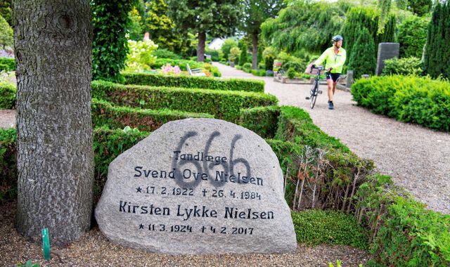 Vandals spray paint graves in Denmark with Satanic '666' graffiti