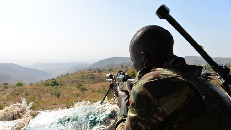 A Cameroon soldier keeps watch for Boko Haram fighters in his country's north