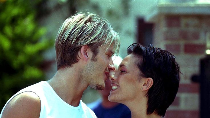 David Beckham (l) And Fiance Spice Girl Victoria Adams Smile pose ahead of their wedding in 1999