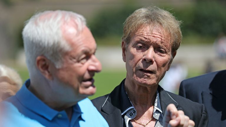 Sir Cliff Richard (right) watches Paul Gambaccini at an event in Westminster, London, to launch a campaign for a ban on naming sexual crime suspects unless they are charged.