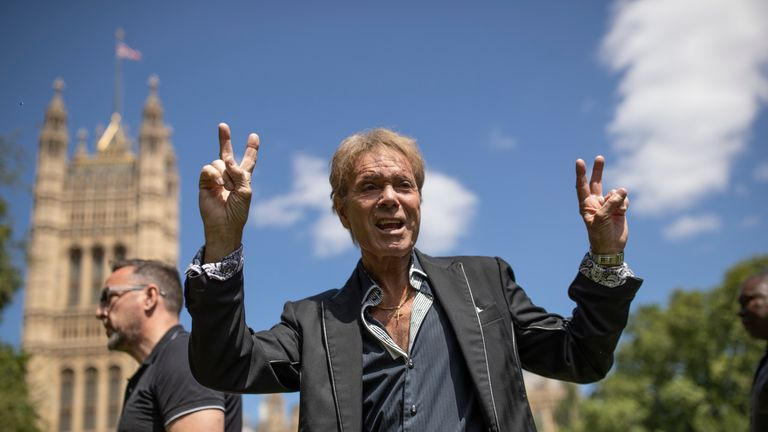 LONDON, ENGLAND - JULY 01: Sir Cliff Richard gestures to fans after speaking to the to the media in Victoria Gardens next to the Houses of Parliament on July 1, 2019 in London, England. Singer Sir Cliff Richard was falsely accused of historical sex offences and now is lending his support to a change in the law to give anonymity to those who are accused of sexual offences until they are charged. (Photo by Dan Kitwood/Getty Images)