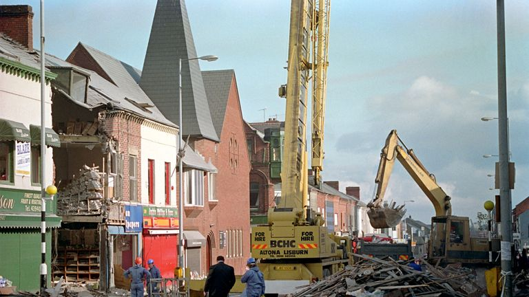 A SCENE OF DEVASTATION IN THE SHANKILL ROAD, AS THE BOMB SITE IS CLEARED UP.