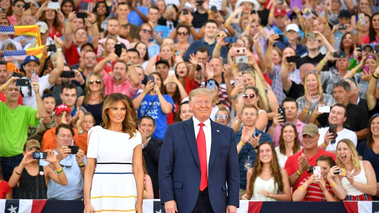 """US President Donald Trump (R) and US First Lady Melania Trump arrive for the """"Salute to America"""" Fourth of July event at the Lincoln Memorial in Washington, DC, July 4, 2019. (Photo by MANDEL NGAN / AFP)        (Photo credit should read MANDEL NGAN/AFP/Getty Images)"""