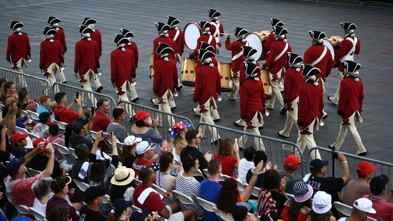 """People watch a marching band perform on the National Mall ahead of the """"Salute to America"""" Fourth of July event with US President Donald Trump at the Lincoln Memorial in Washington, DC, July 4, 2019. (Photo by Brendan Smialowski / AFP)        (Photo credit should read BRENDAN SMIALOWSKI/AFP/Getty Images)"""