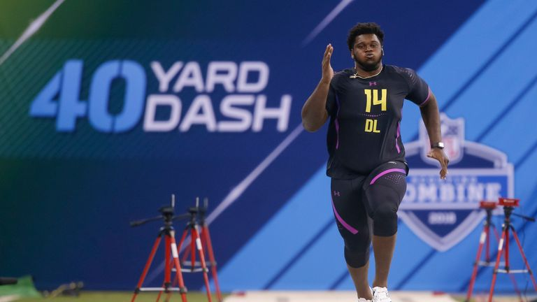INDIANAPOLIS, IN - MARCH 04: Miami (FL) defensive lineman Kendrick Norton (DL14) runs in the 40 yard dash during the NFL Scouting Combine at Lucas Oil Stadium on March 4, 2018 in Indianapolis, Indiana. (Photo by Michael Hickey/Getty Images)