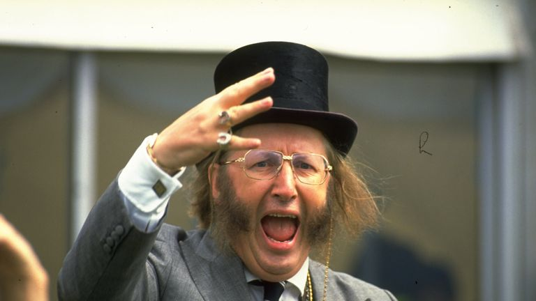 1990:  John McCririck a television Channel Four commentator doing his version of the Tic Tac at the Epsom Derby.               \ Mandatory Credit: Allsport  UK/Allsport
