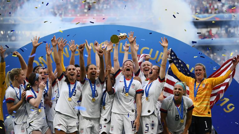 USA's players celebrate with the trophy after the France 2019 Womens World Cup football final match between USA and the Netherlands, on July 7, 2019, at the Lyon Stadium in Lyon, central-eastern France. (Photo by FRANCK FIFE / AFP)        (Photo credit should read FRANCK FIFE/AFP/Getty Images)