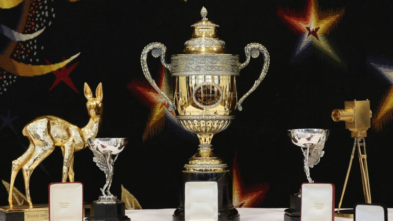 A selection of trophies, awards, and memorabilia from the tennis career of Boris Becker, including the Wimbledon singles trophy (centre top), on show in central London before being sold.