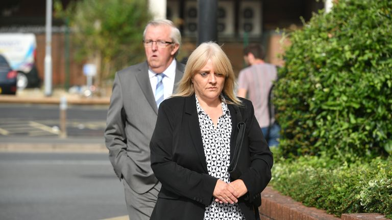Sherry Bray, 48, and Christopher Ashford, 62, leave Swindon Magistrates' Court where they where summonsed to appear over an image that allegedly showed the remains of footballer Emiliano Sala at the Holly Tree Lodge mortuary in Bournemouth.