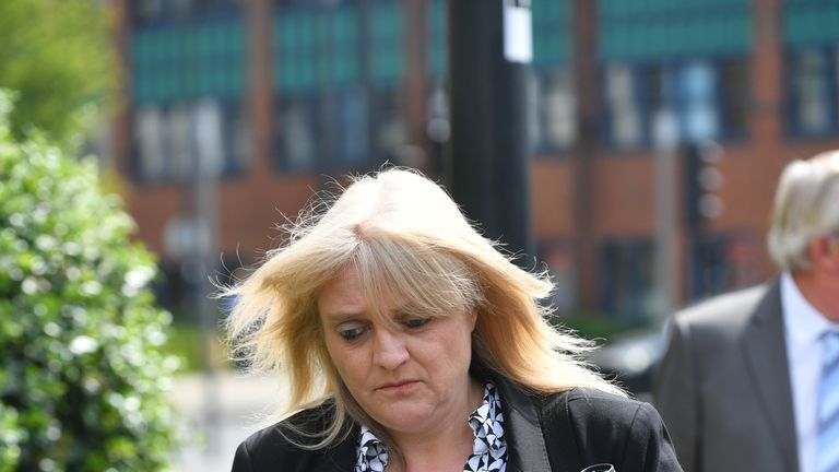 Sherry Bray, 48, leaves Swindon Magistrates' Court where she and Christopher Ashford, 62, were summonsed to appear over an image that allegedly showed the remains of footballer Emiliano Sala at the Holly Tree Lodge mortuary in Bournemouth.