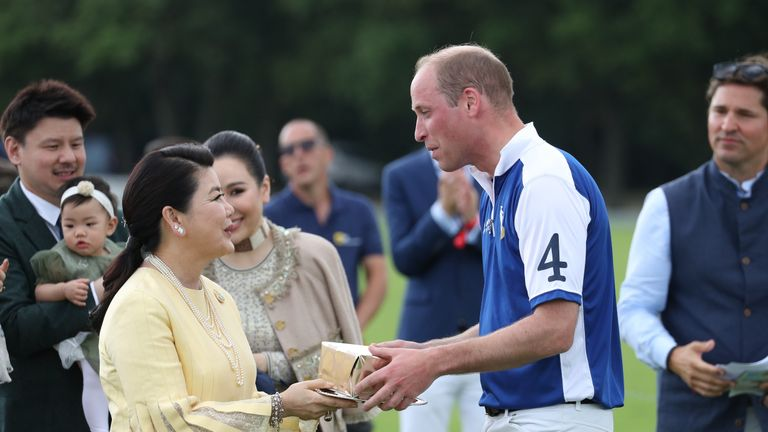 The Duke of Cambridge with Aimon Srivaddhanaprabha, after he played in the Khun Vichai Srivaddhanaprabha Memorial Polo Trophy during the King Power Royal Charity Polo Day at Billingbear Polo Club, Wokingham, Berkshire.