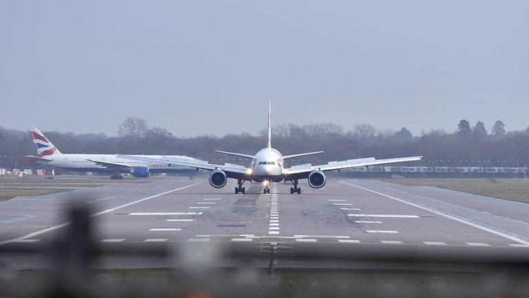 A British Airways plane lands at Gatwick airport which had been closed after drones were spotted over the airfield Wednesday night and throughout Thursday.