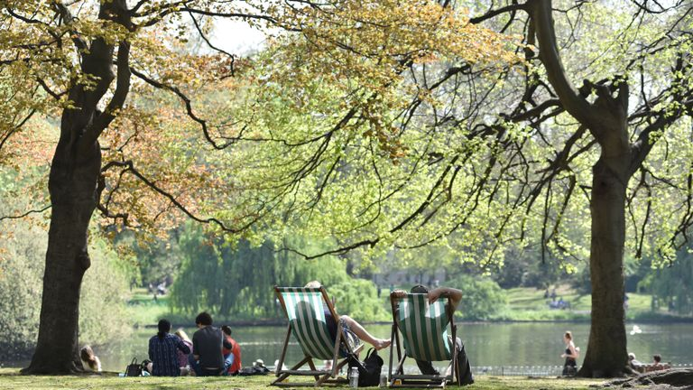 LONDON, ENGLAND  - APRIL 22: People relax and enjoy the sunshine in deck chairs by the lake in St James's Park on April 22, 2019 in London, England. This Easter weekend has broken previous hot weather records with the warm weather expected to continue into next week. (Photo by John Keeble/Getty Images)
