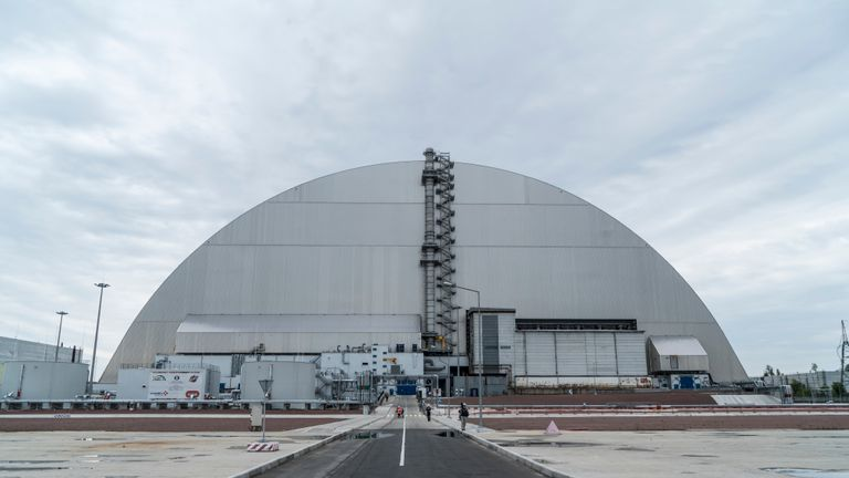 PRIPYAT, UKRAINE - JULY 2: The 'New Safe Confinement' at the Chernobyl Nuclear Power Plant on July 2, 2019 in Pripyat, Ukraine. In November 2016, the 'New Safe Confinement' structure was shifted into place to prevent the decaying reactor from further contaminating the environment and eventually allow its dismantling; the Ukrainian government will soon be taking control of the new confinement structure. The power station's reactor number four exploded in April 1986, showering radiation over the local area, nearby regions of Belarus, and other portions of Europe. (Photo by Brendan Hoffman/Getty Images)