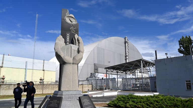 A picture shows a monument near the  New Safe Confinement (NSC) new metal dome designed and built by French consortium Novarka encasing the destroyed reactor at Chernobyl plant on July 10, 2019, in Chernobyl. - Ukraine and its European partners on July 10 formally inaugurated a new metal dome encasing the destroyed reactor at the infamous Chernobyl plant, wrapping up a two-decade effort. Branded as the world's largest moveable metal structure, the so-called New Safe Confinement seals the remains of the fourth reactor at the nuclear plant that was the site of the massive Chernobyl disaster in 1986. (Photo by SERGEI SUPINSKY / AFP)        (Photo credit should read SERGEI SUPINSKY/AFP/Getty Images)