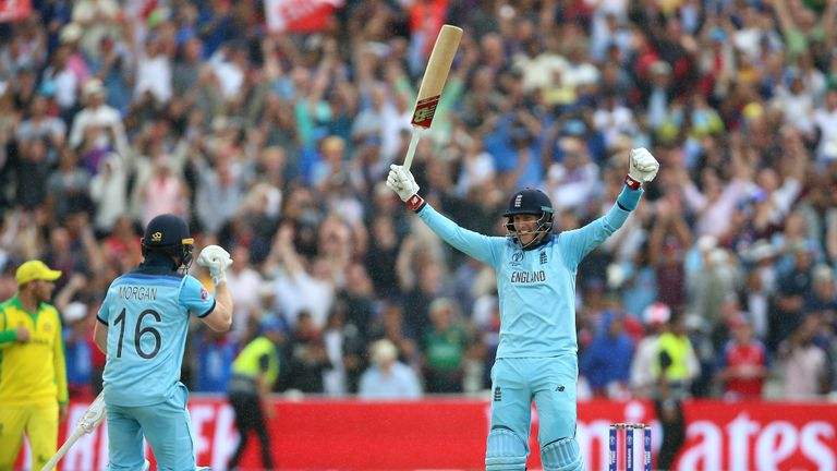 England's Eoin Morgan (left) and Joe Root celebrate victory against Australia during the ICC World Cup, Semi Final at Edgbaston, Birmingham.