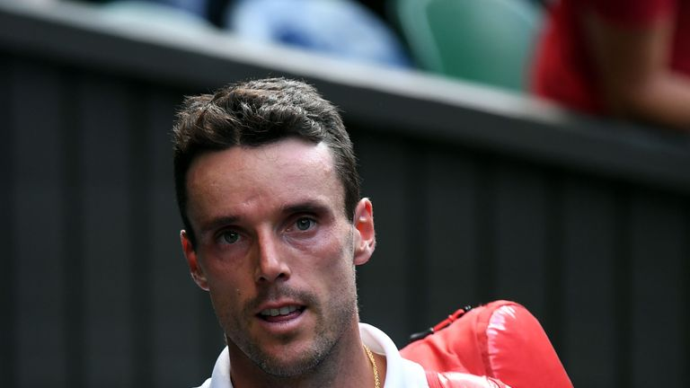 Spain's Roberto Bautista Agut leaves after being beaten by Serbia's Novak Djokovic during their men's singles semi-final match on day 11 of the 2019 Wimbledon Championships at The All England Lawn Tennis Club in Wimbledon, southwest London, on July 12, 2019. (Photo by Ben STANSALL / AFP) / RESTRICTED TO EDITORIAL USE        (Photo credit should read BEN STANSALL/AFP/Getty Images)