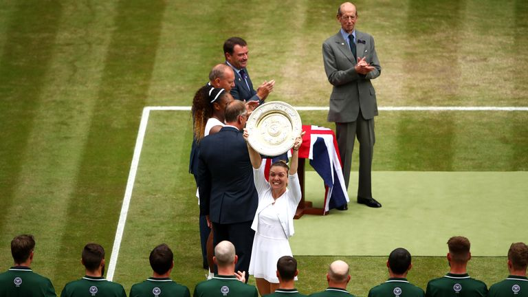 LONDON, ENGLAND - JULY 13: Simona Halep of Romania celebrates with the trophy after winning the Ladies' Singles final against Serena Williams of The United States during Day twelve of The Championships - Wimbledon 2019 at All England Lawn Tennis and Croquet Club on July 13, 2019 in London, England. (Photo by Clive Brunskill/Getty Images)