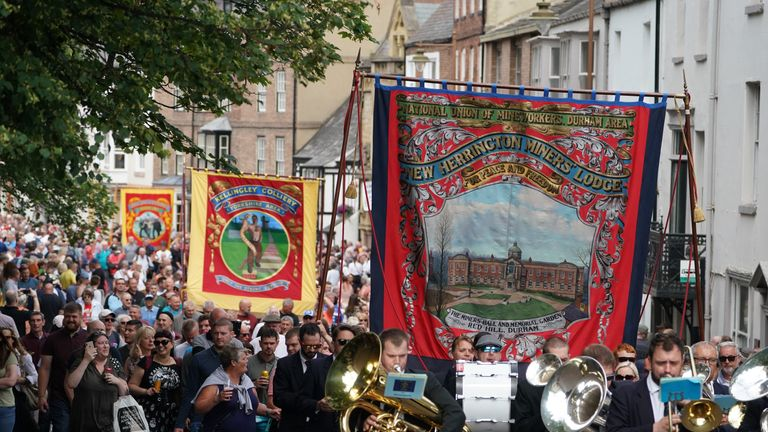 Pipe bands and banners parade through Durham during the Durham Miners' Gala.