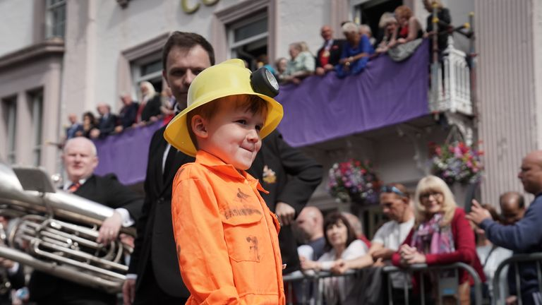 Dylan Clarkson, 6, parades through Durham during the Durham Miners' Gala.