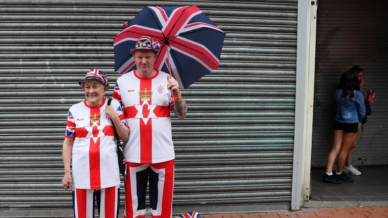 Supporters attend an Orange Order parade in Belfast, as part of the annual Twelfth of July celebrations, marking the victory of King William III's victory over James II at the Battle of the Boyne in 1690.