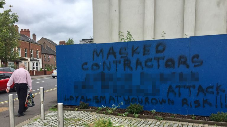 NAMES PIXELATED BY PA PICTURE DESK Graffiti near the Avoniel bonfire site. A stand-off over the contentious loyalist bonfire in Belfast has ended after councillors backed down over plans to demolish it.