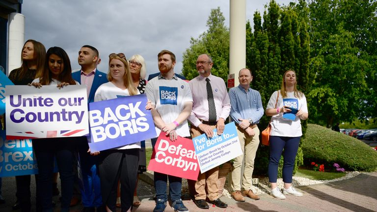 COLCHESTER, ENGLAND - JULY 13: People wait for the arrival of Boris Johnson to address Conservative Party members during a hustings on July 13, 2019 in Colchester, England. The race between Boris Johnson and Jeremy Hunt to find the next leader of the Conservative Party and Prime Minister is now entering it's final stages. (Photo by Leon Neal/Getty Images)