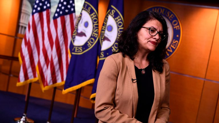 "US Representative Rashida Tlaib (D-MI) looks on during an interview after a press conference, to address remarks made by US President Donald Trump earlier in the day, at the US Capitol in Washington, DC on July 15, 2019. - President Donald Trump stepped up his attacks on four progressive Democratic congresswomen, saying if they're not happy in the United States ""they can leave."" (Photo by Brendan Smialowski / AFP)        (Photo credit should read BRENDAN SMIALOWSKI/AFP/Getty Images)"