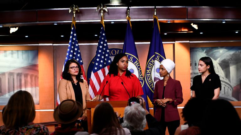 "TOPSHOT - US Representatives Ayanna Pressley (D-MA) speaks as, Ilhan Omar (D-MN)(2R), Rashida Tlaib (D-MI) (R), and Alexandria Ocasio-Cortez (D-NY) look on during a press conference, to address remarks made by US President Donald Trump earlier in the day, at the US Capitol in Washington, DC on July 15, 2019. - President Donald Trump stepped up his attacks on four progressive Democratic congresswomen, saying if they're not happy in the United States ""they can leave."" (Photo by Brendan Smialowski / AFP)        (Photo credit should read BRENDAN SMIALOWSKI/AFP/Getty Images)"