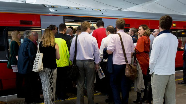 File photo dated 28/07/16 of commuters waiting to board a train. Rail commuters returning to work after the bank holiday break faced disruption on Tuesday because of a points failure.
