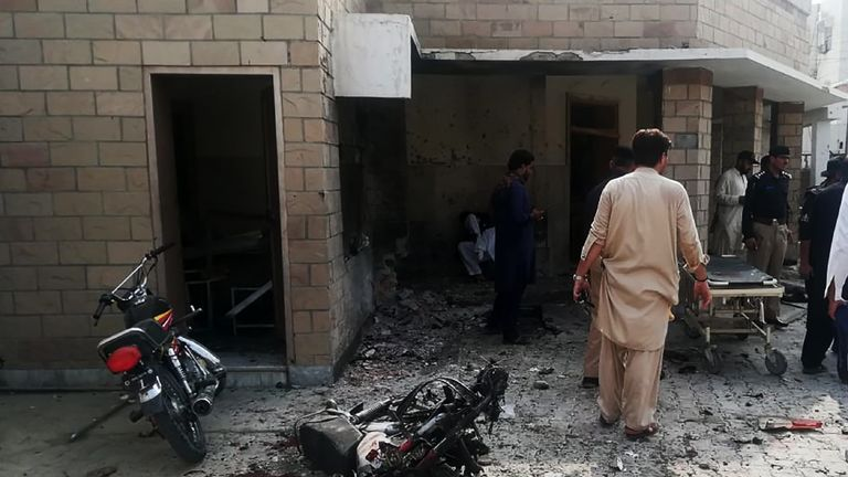 Pakistani security officials examine the site of a suicide bomb attack at the entrance of a hospital in Kotlan Saidan village on the outskirts of the northwestern city of Dera Ismail Khan on July 21, 2019. - A female suicide bomber killed six people -- including two policemen -- in Pakistan's restive northwest on July 21 in an attack claimed by the Taliban, officials said. The attack happened at the entrance of a hospital in Kotlan Saidan village on the outskirts of the northwestern city of Dera Ismail Khan. (Photo by Adil Mughal / AFP)        (Photo credit should read ADIL MUGHAL/AFP/Getty Images)