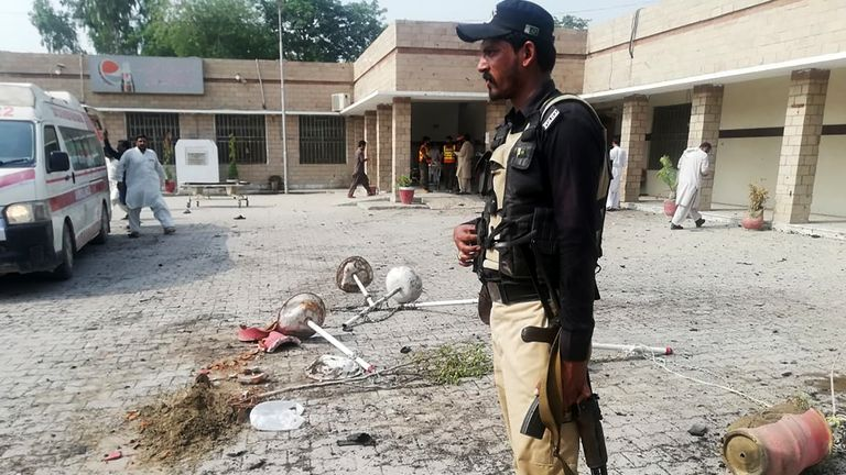 A Pakistani policeman stands guard at site of a suicide bomb attack a hospital entrance in Kotlan Saidan village on the outskirts of the northwestern city of Dera Ismail Khan on July 21, 2019. - A female suicide bomber killed six people -- including two policemen -- in Pakistan's restive northwest on July 21 in an attack claimed by the Taliban, officials said. The attack happened at the entrance of a hospital in Kotlan Saidan village on the outskirts of the northwestern city of Dera Ismail Khan. (Photo by Adil Mughal / AFP)        (Photo credit should read ADIL MUGHAL/AFP/Getty Images)