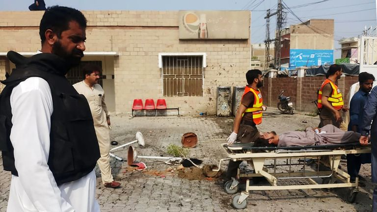 Pakistani rescue personnel move an injured blast victim of a suicide bomb attack at the entrance of a hospital in Kotlan Saidan village on the outskirts of the northwestern city of Dera Ismail Khan on July 21, 2019. - A female suicide bomber killed six people -- including two policemen -- in Pakistan's restive northwest on July 21 in an attack claimed by the Taliban, officials said. The attack happened at the entrance of a hospital in Kotlan Saidan village on the outskirts of the northwestern city of Dera Ismail Khan. (Photo by ADIL MUGHAL / AFP)        (Photo credit should read ADIL MUGHAL/AFP/Getty Images)