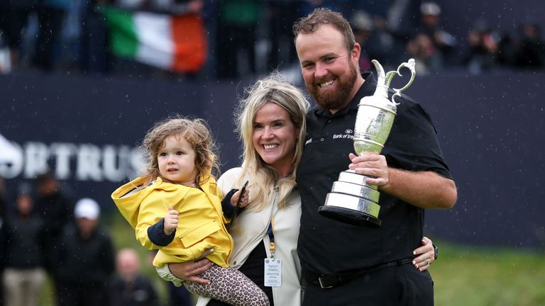 Republic Of Ireland's Shane Lowry celebrates with wife Wendy Honner and daughter after winning the Claret Jug during day four of The Open Championship 2019 at Royal Portrush Golf Club.