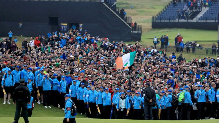 PORTRUSH, NORTHERN IRELAND - JULY 21: Huge crowds watch the 18th green as the final match finishes during the final round of the 148th Open Championship held on the Dunluce Links at Royal Portrush Golf Club on July 21, 2019 in Portrush, United Kingdom. (Photo by David Cannon/Getty Images)