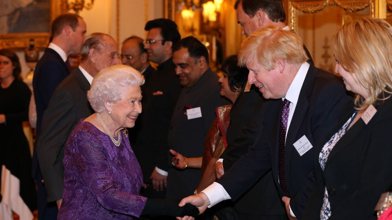 LONDON, ENGLAND - FEBRUARY 27:  Queen Elizabeth II greets Foreign Secretary Boris Johnson at a reception this evening to mark the launch of the UK-India Year of Culture 2017 on February 27, 2017 in London, England. (Photo by Jonathan Brady - WPA Pool/Getty Images)
