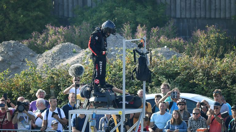 "Zapata CEO Franky Zapata (C) prepares before an attempt of a flight across the Channel standing on a jet-powered ""flyboard"" on July 25, 2019 in Sangatte, northern France. - Franky Zapata, a former jet-skiing champion, aims to soar above the Channel ""like a bird"" in the crossing from northern France to southern England, in a scene likely to resemble a science fiction film. In a tribute to past aviation heroes, the 40-year-old has picked the day that marks 110 years since pioneer Louis Bleriot made the first airplane flight across the Channel on July 25, 1909. (Photo by Denis Charlet / AFP)        (Photo credit should read DENIS CHARLET/AFP/Getty Images)"