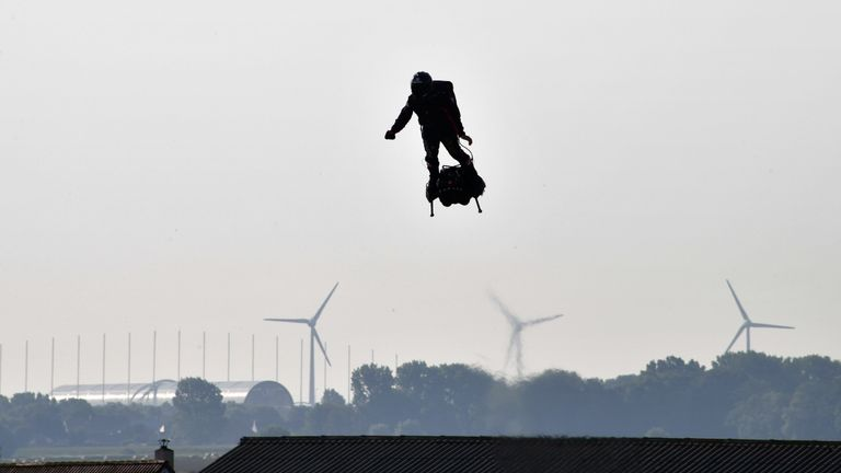"Franky Zapata (C) stands on his jet-powered ""flyboard"" as he takes off from Sangatte, northern France, attempting to fly across the 35-kilometre (22-mile) Channel crossing in 20 minutes, while keeping an average speed of 140 kilometres an hour (87 mph) at a height of 15-20 metres (50-65 feet) above the sea on July 25, 2019. - Zapata CEO Franky Zapata, a former jet-skiing champion, aims to soar above the Channel ""like a bird"" in the crossing from northern France to southern England, in a scene likely to resemble a science fiction film. In a tribute to past aviation heroes, the 40-year-old has picked the day that marks 110 years since pioneer Louis Bleriot made the first airplane flight across the Channel on July 25, 1909. (Photo by Denis Charlet / AFP)        (Photo credit should read DENIS CHARLET/AFP/Getty Images)"