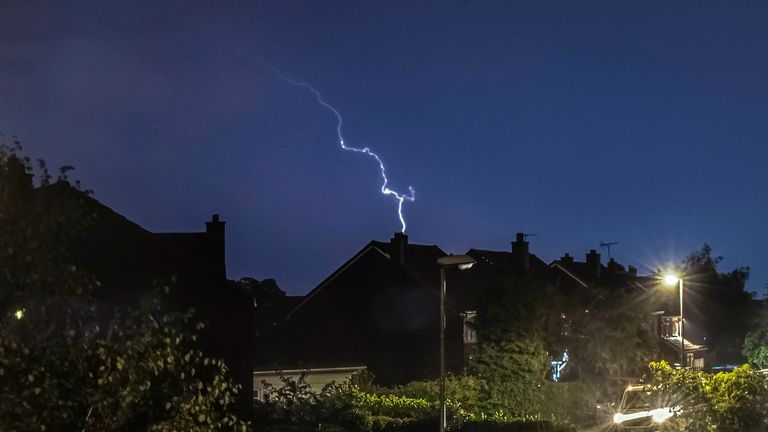 Lightning strikes as a thunder storm passes over houses in Leeds, West Yorkshire. The UK is expected to edge towards its hottest ever July day, with the mercury due to soar above 30C (86F).