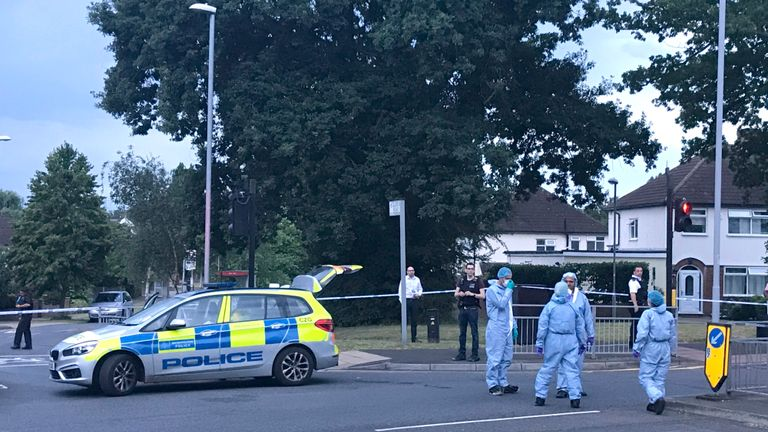"""Forensics officers on Moor Lane in Chessington following a hit-and-run incident where a man died after being """"dragged under a car""""."""