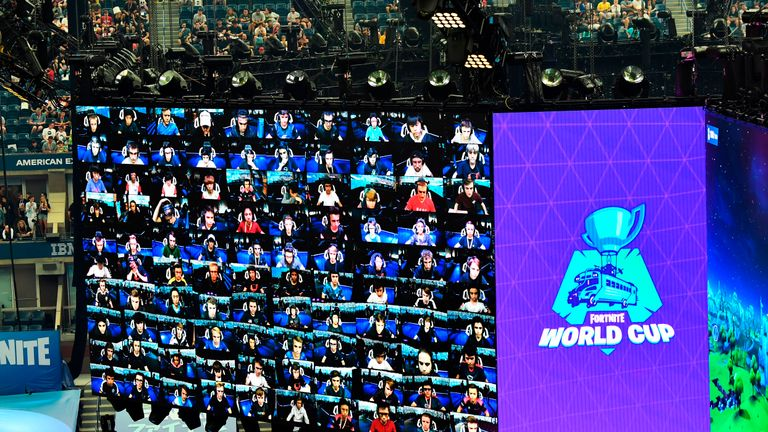 Players are seen on screen during the final of the Solo competition at the 2019 Fortnite World Cup July 28, 2019 inside of Arthur Ashe Stadium, in New York City. (Photo by Johannes EISELE / AFP)        (Photo credit should read JOHANNES EISELE/AFP/Getty Images)