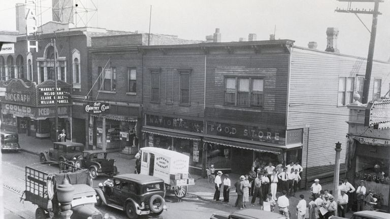 (Original Caption) 7/24/1934-Chicago, IL- A daylight view of the scene of the killing of John Dillinger in Chicago. He had attended a movie in the theatre at the left when Federal agents closed in on him. They had him surrounded when he reached the alley and shot and killed him when he attempted to draw a gun.